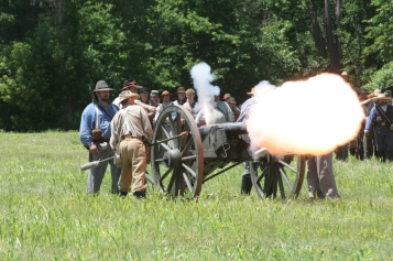 Reenactors demonstrate cannon fire in St. Joseph, Missouri.