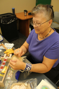 Judith Manthe, member of the Wyandot Nation of Kansas, demonstrates traditional crafts at the 2014 Native Neighbors event in Ottawa, Kansas.