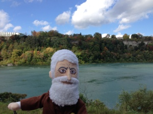 Mini Old John Brown contemplates international Underground Railroad connections to Canada from the banks of the Niagara River.